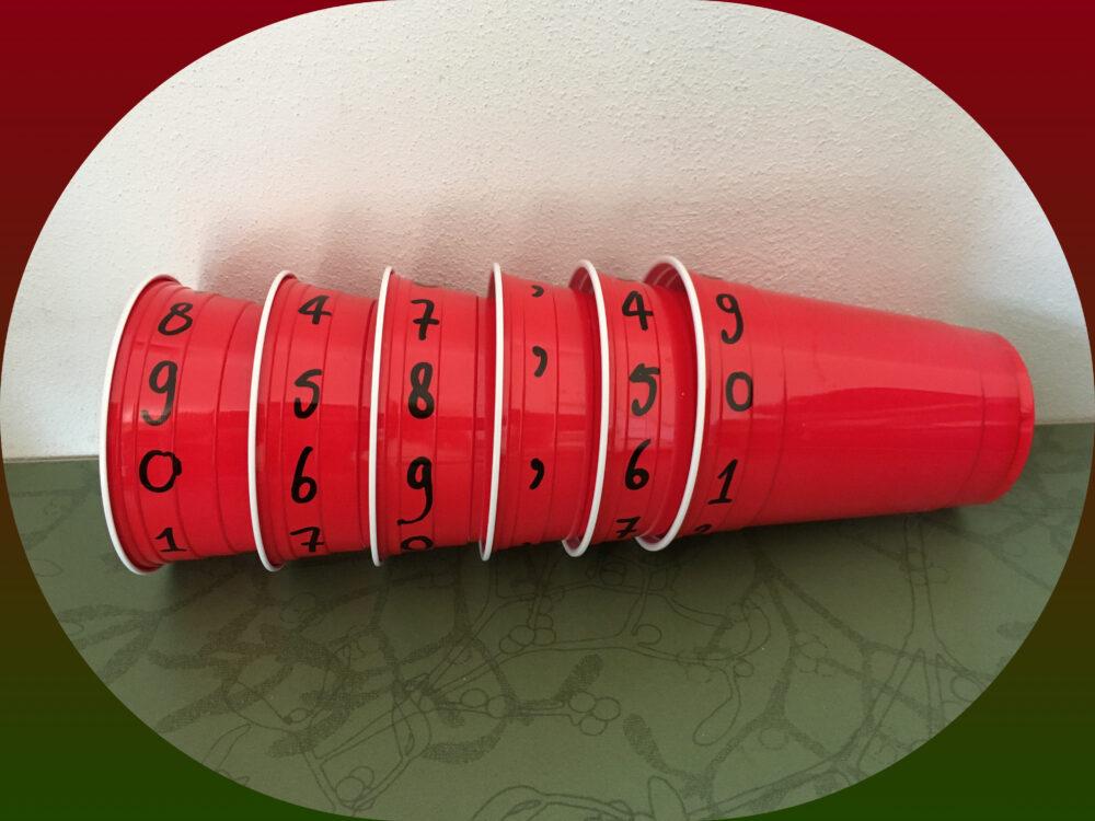 Getallen maken met bekertjes (grote getallen, komma getallen)